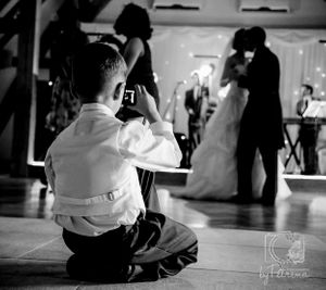 Page boy taking a photograph of the first dance