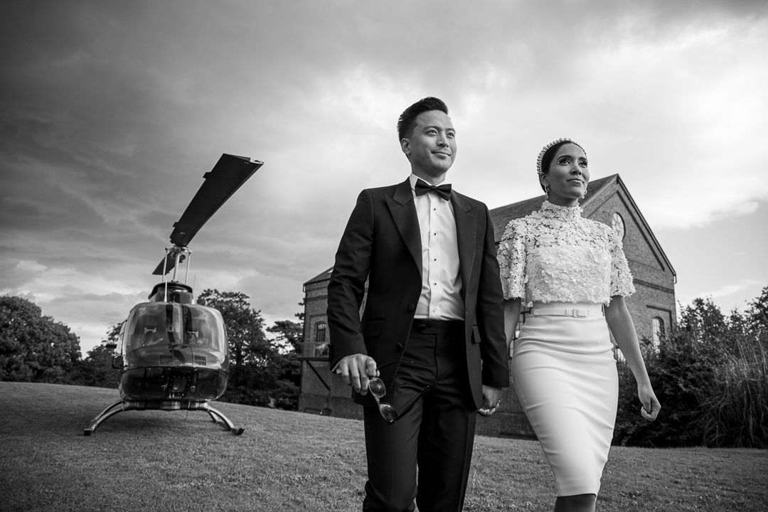 Bride and groom arriving at their wedding in a helicopter