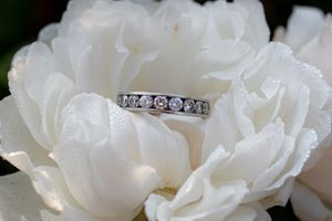 Wedding ring on a rose