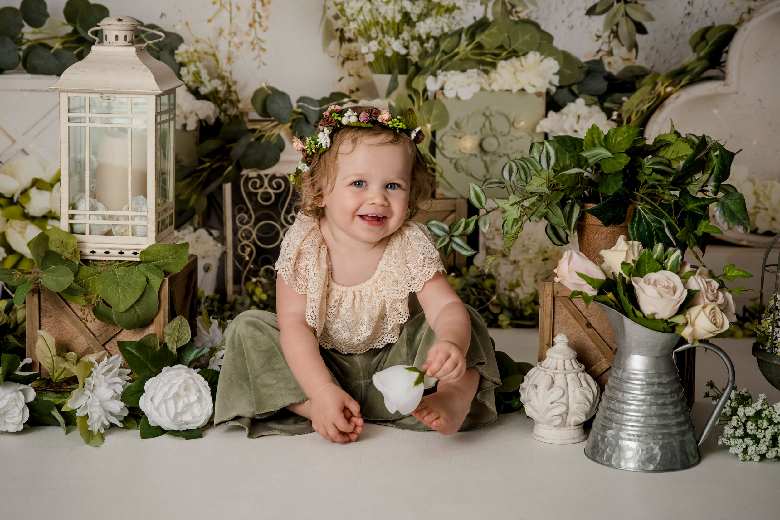 one year old girl with boho flowers