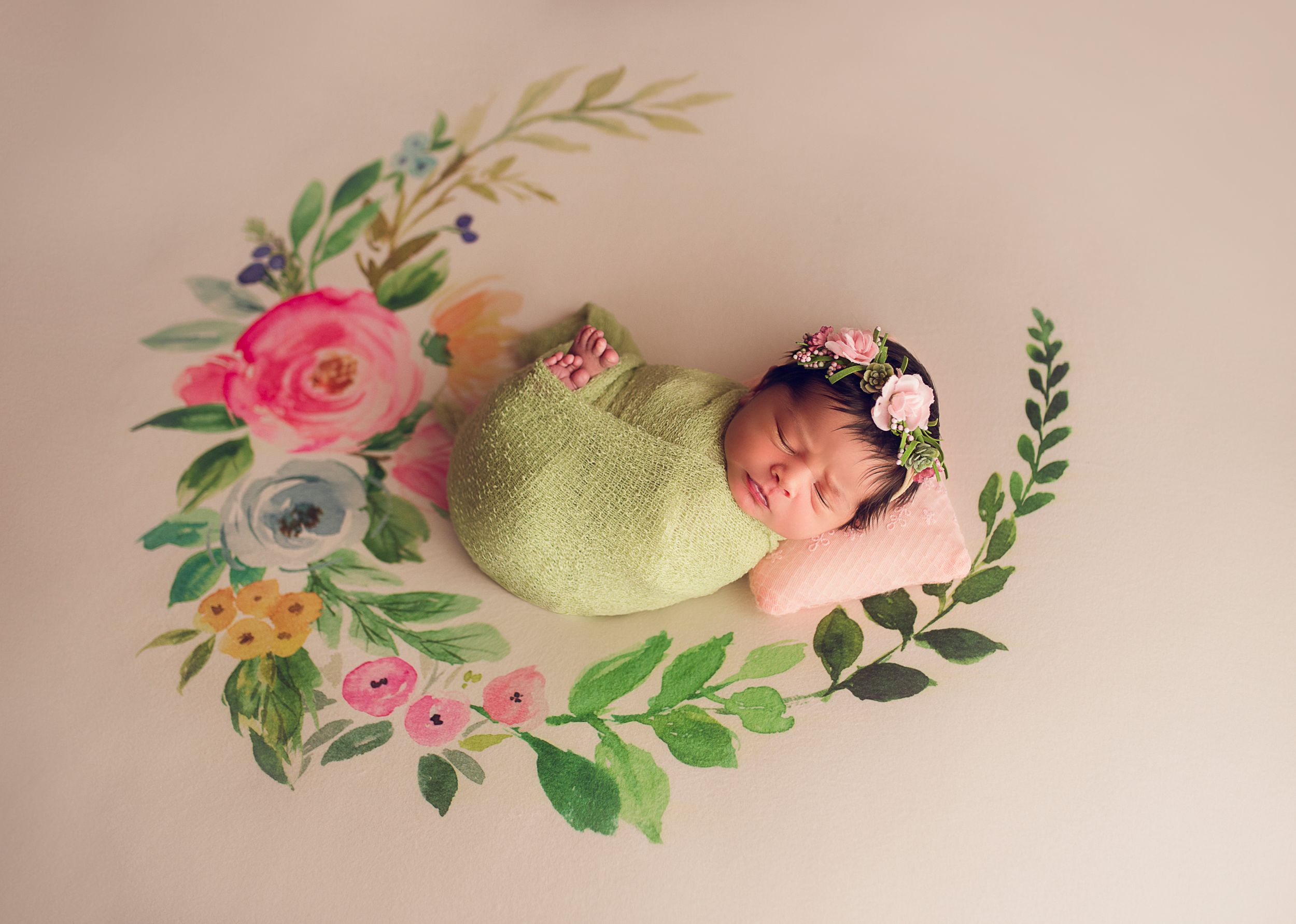 floral backdrop newborn baby wrapped in green