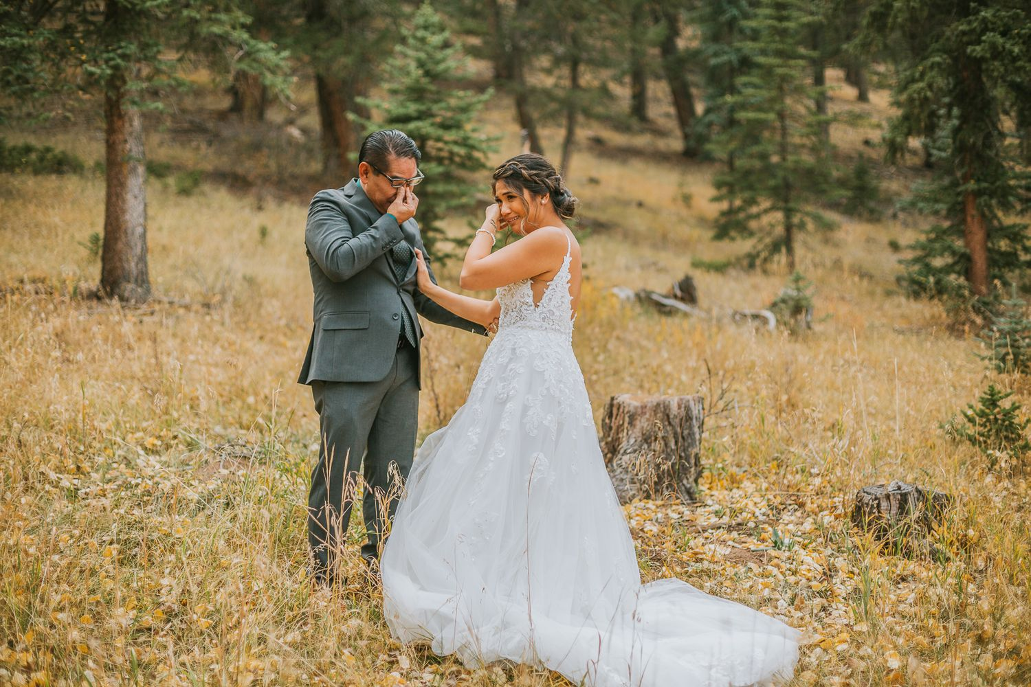 A bride and her father cry at Mountain View Ranch during her Bailey, Colorado Wedding.