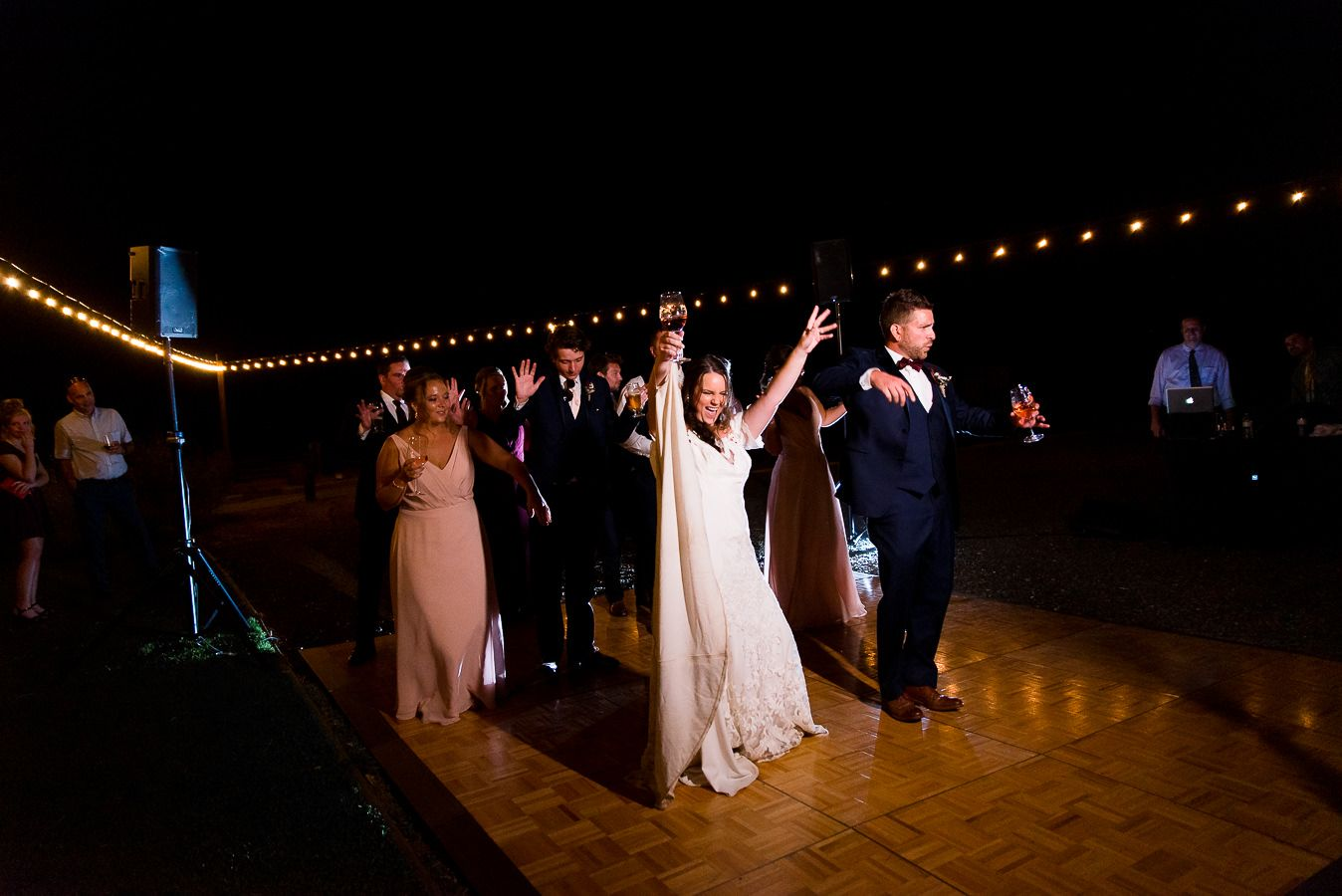 bride and groom dance with hands in air at Pennyroyal Farm wedding