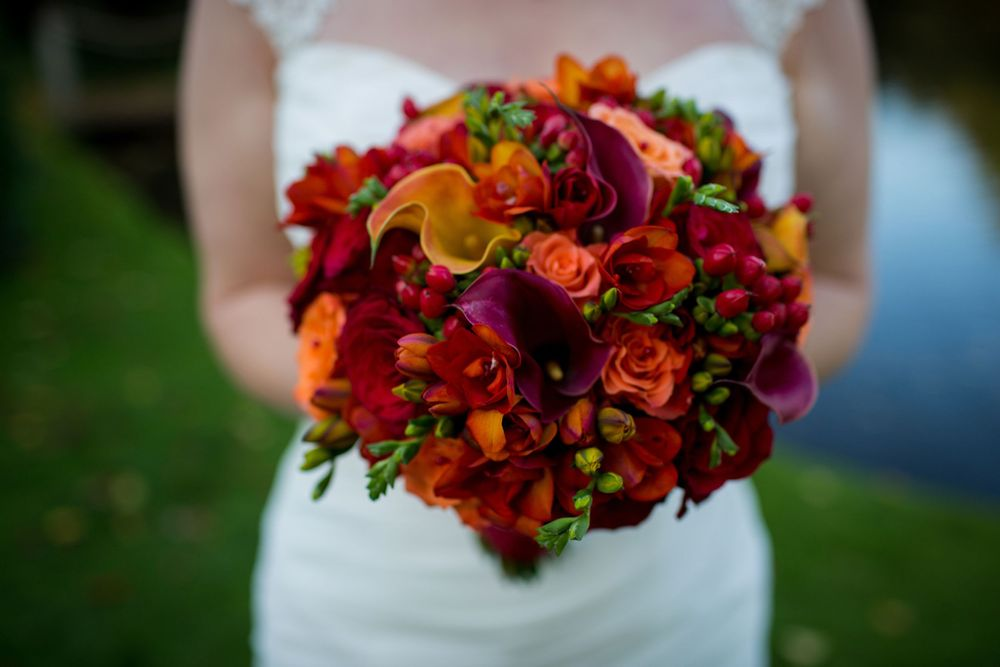 red orange and pink bridal bouquet