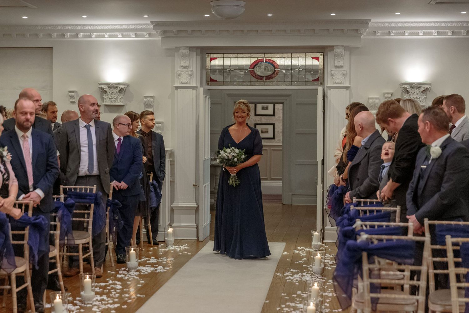 maid of honour walks up the aisle at ashfield house wigan