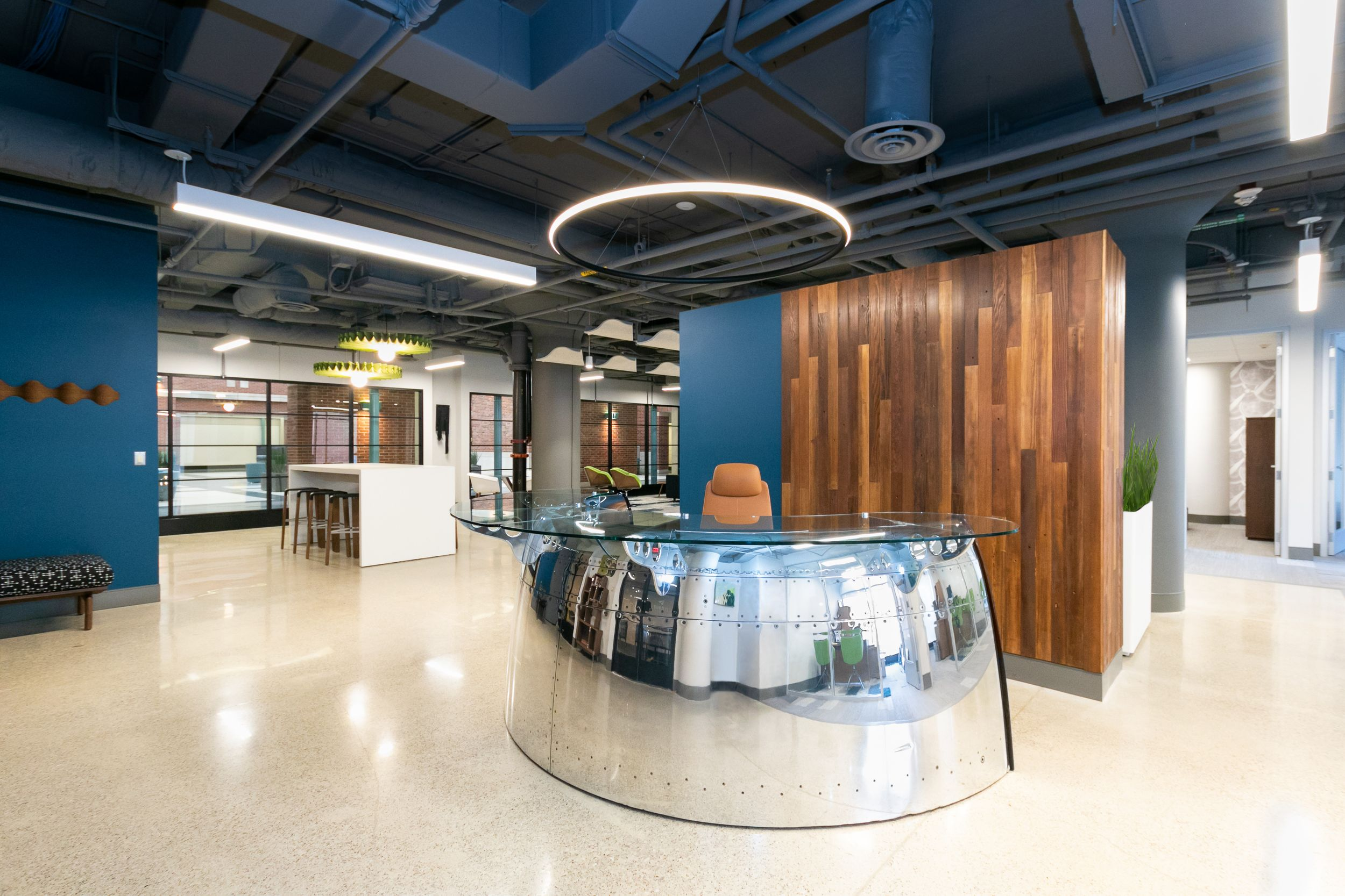 Customer reception design built from a Boeing 747 propeller welcomes visitors into Burris Law firm in Detroit.