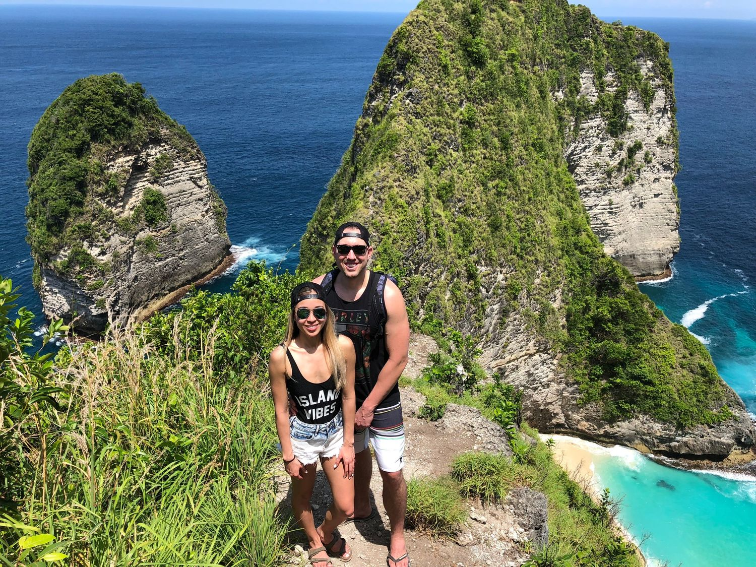 Man and woman posing in front on Nusa Penida