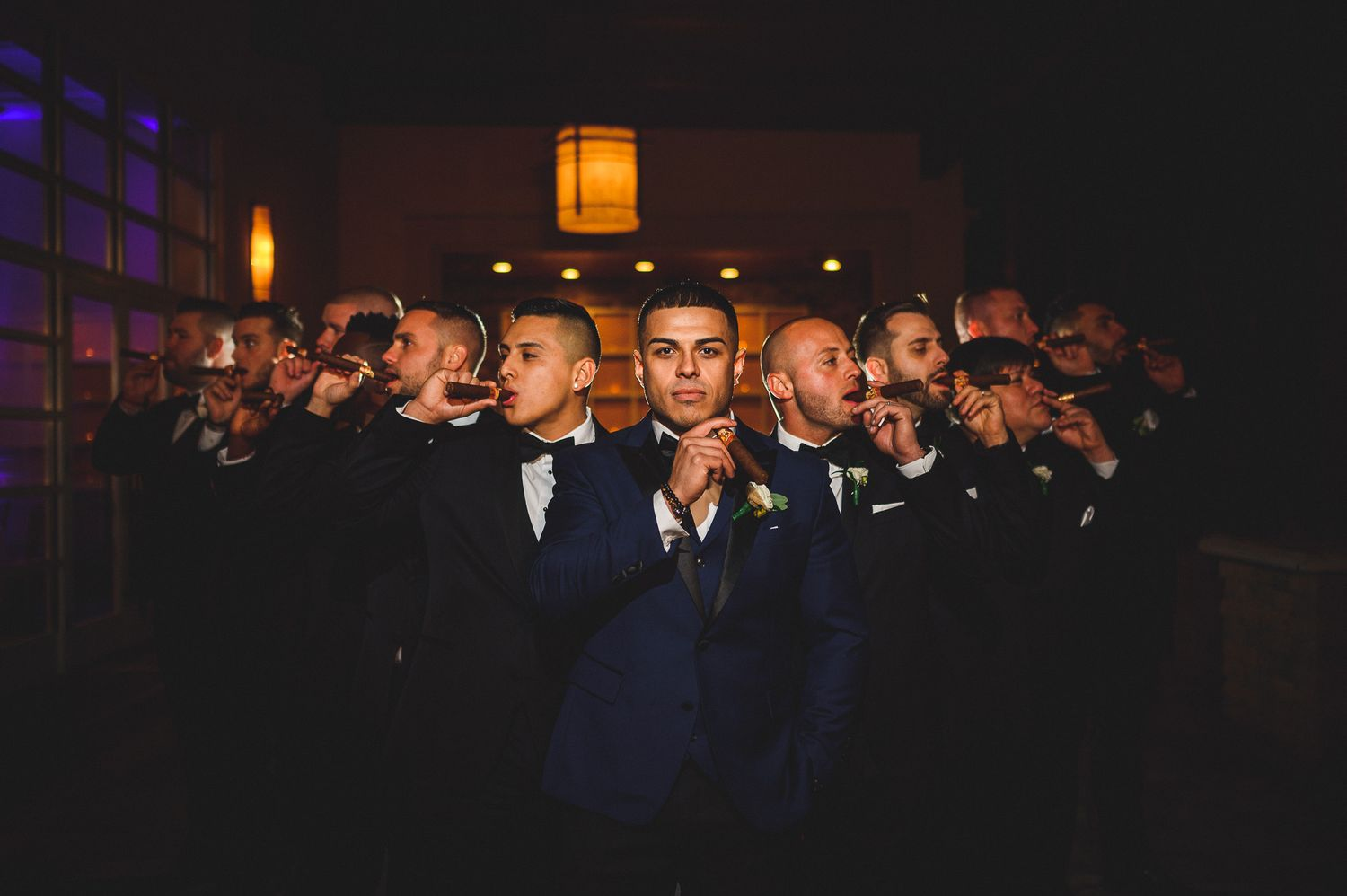 groomsman wise guy portrait with cigars at stone house