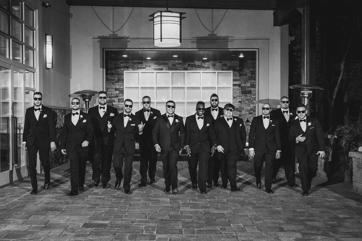 groomsman portrait walking at stone house