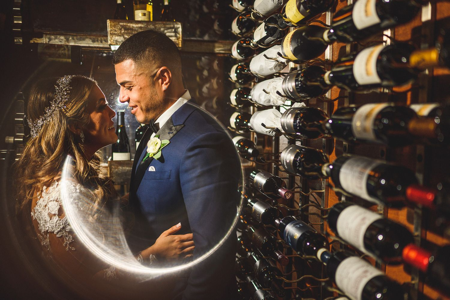 bride and groom wine portrait at stone house