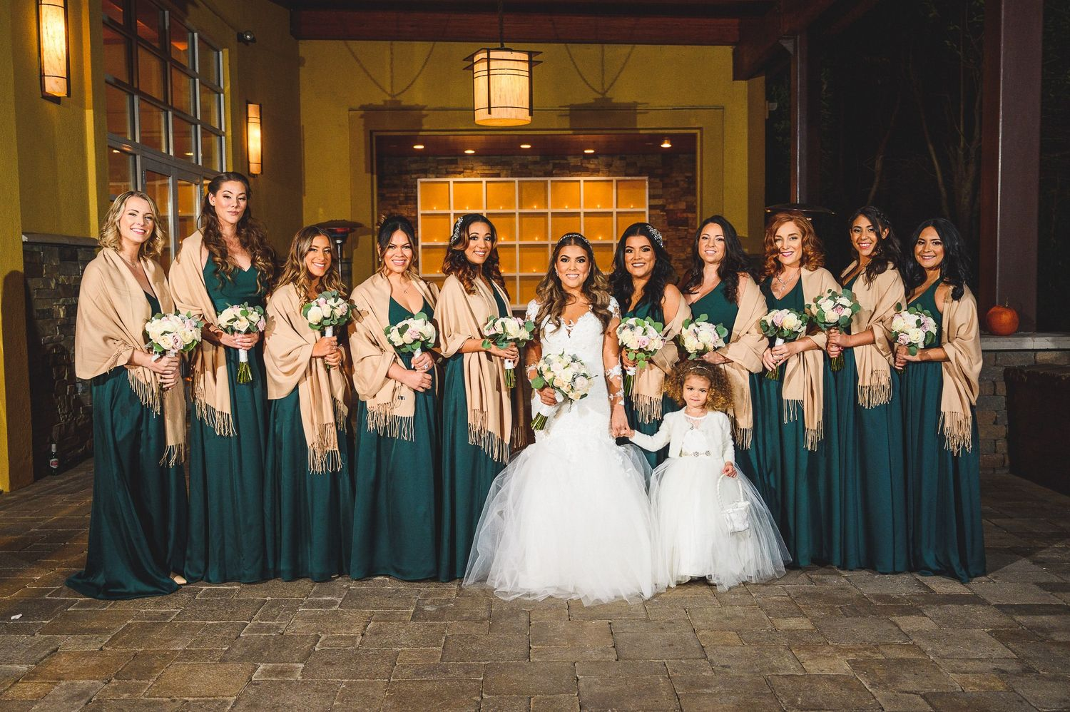 bridal party portrait at stone house at stirling ridge