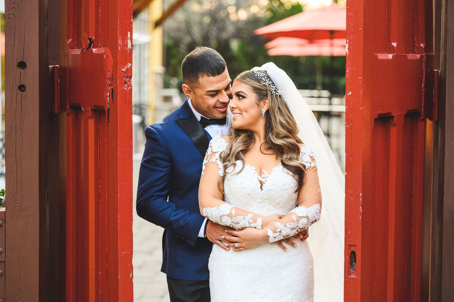 bride and groom portrait at the red doors at stone house