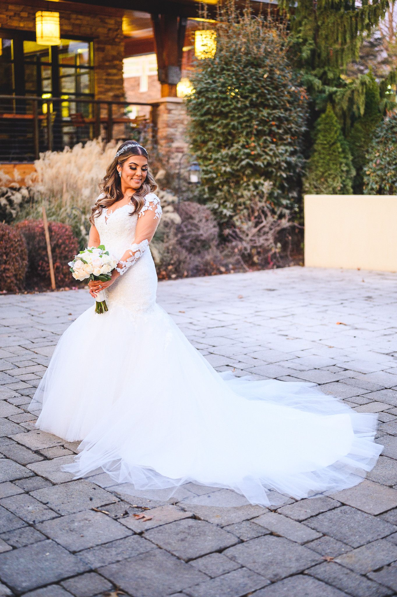 full length bridal portrait in white dress at stone house