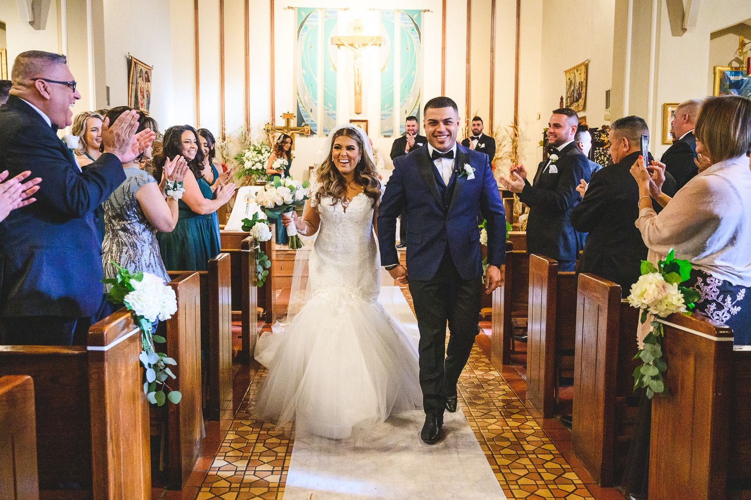 bride and groom walking down isle after being married