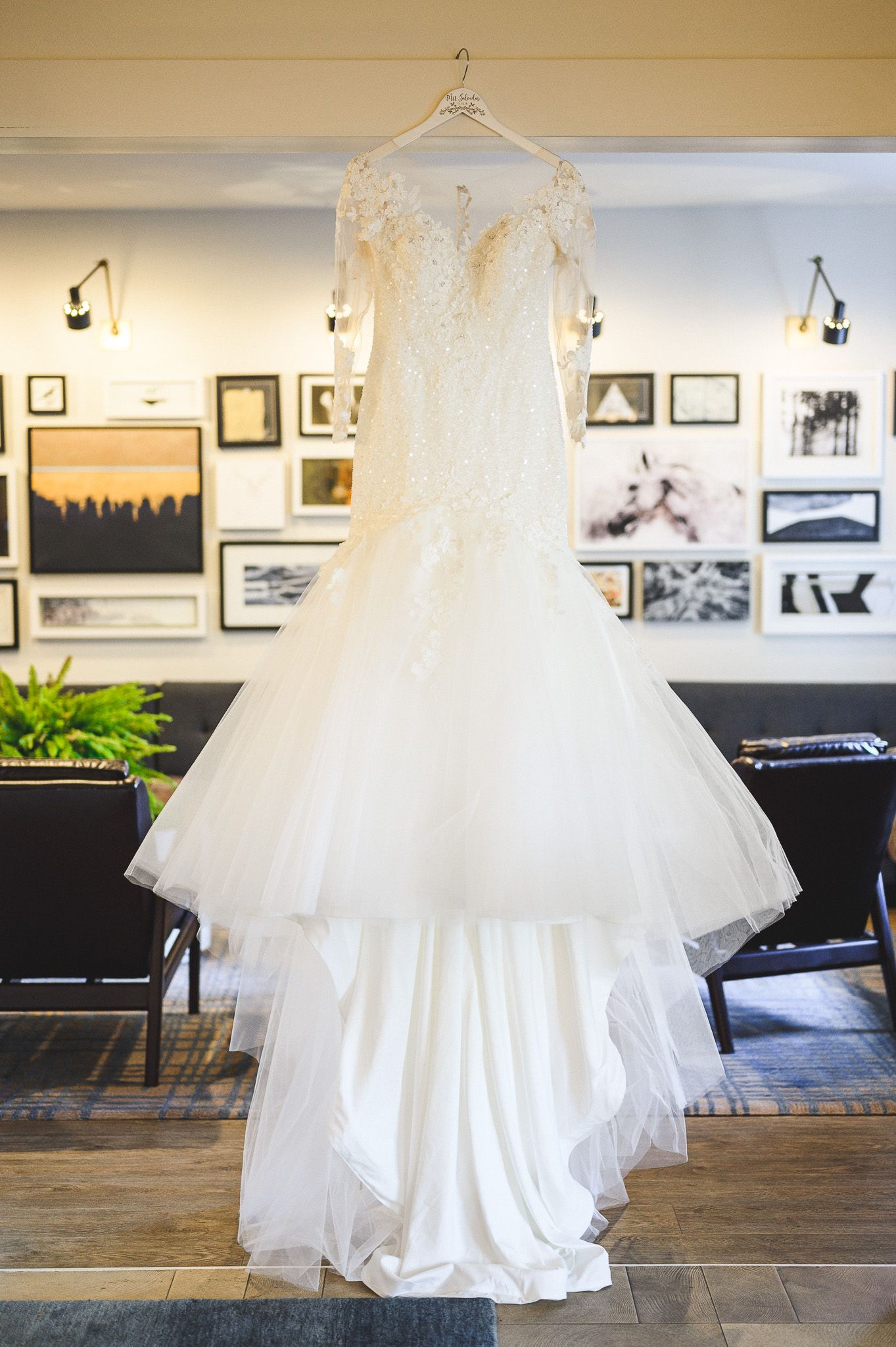 bride's dress hanging in hotel details