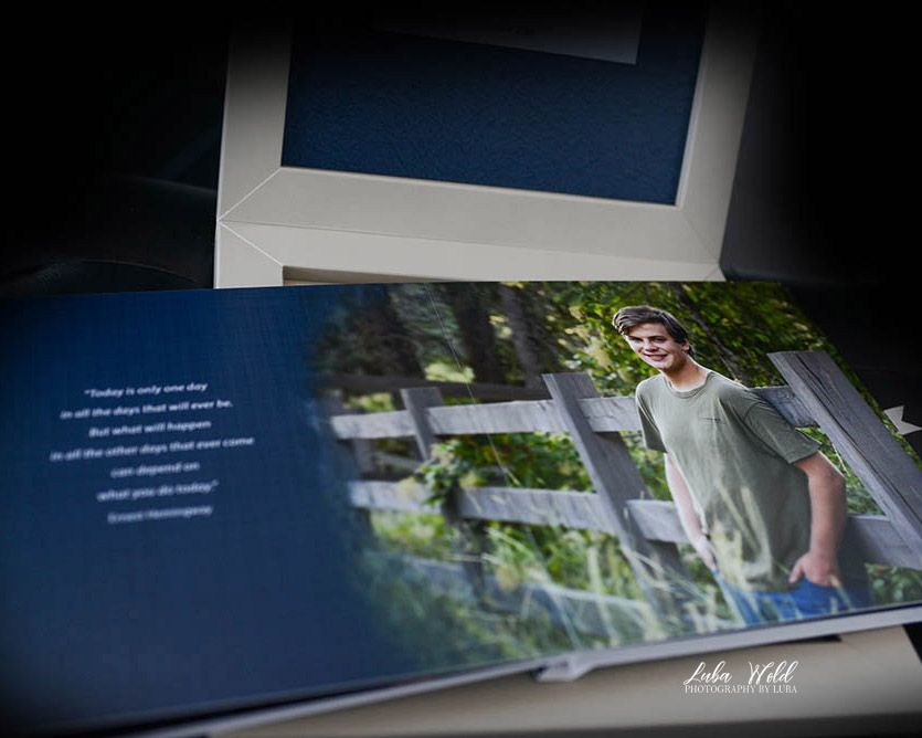 high school senior photo book featuring a boy standing by a fence taken by luba wold in coeur d'alene, Idaho