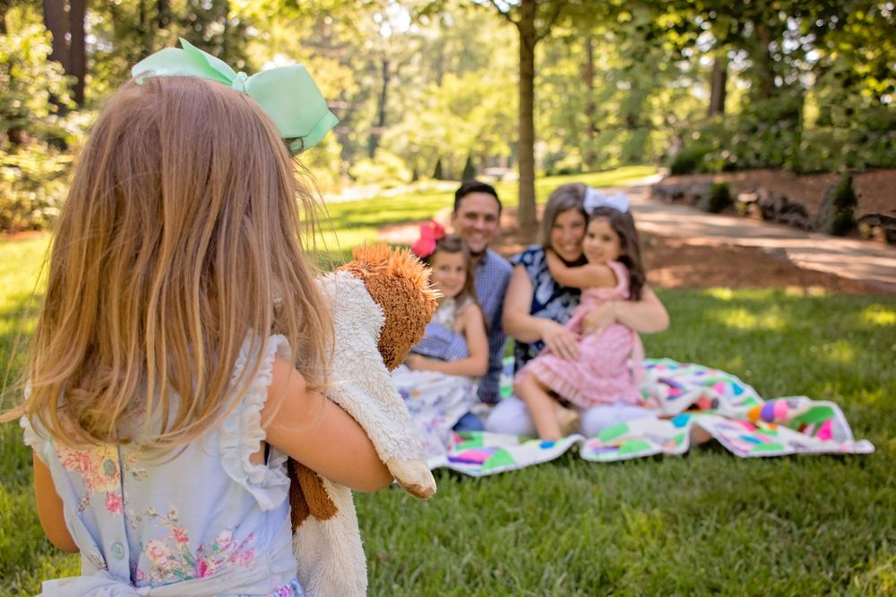 Little girl hugging her stuffed animal at Glencairn Gardens