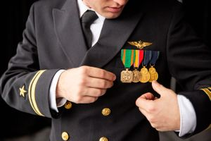 USNA graduate and groom to be adjusting his service metals before ceremony in Annapolis MD