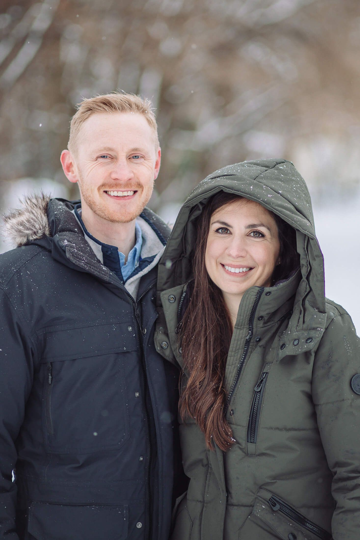 Snow winter couple with engagement photographer in Collingswood, NJ.