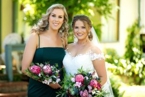 Bride with bridesmaid at The Chapel at Gold Creek wedding in Canberra