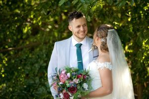 Groom smiling at bride on their wedding day at The Chapel at Gold Creek in Canberra