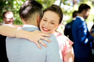 Woman hugging groom after his wedding ceremony at The Chapel at Gold Creek in Canberra