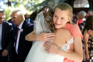 Wedding guest hugging bride after ceremony at The Chapel at Gold Creek in Canberra