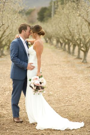 Bride and groom portraits in the olive grove at Pialligo Estate in Canberra