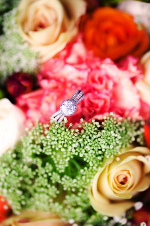 Silver engagement ring in wedding bouquet of flowers at Mount Stromloin Canberra
