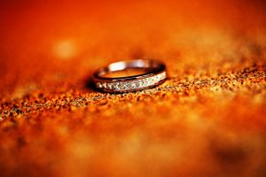 Wedding ring with diamonds on orange stone at Saint Christophers Church Manuka in Canberra
