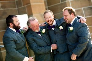 Groomsmen hugging groom before wedding ceremony at Saint Christopher's church Manuka  in Canberra