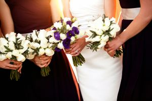 White and purple bridesmaid flower bouquets at The Carillon lake Burley Griffin in Canberra
