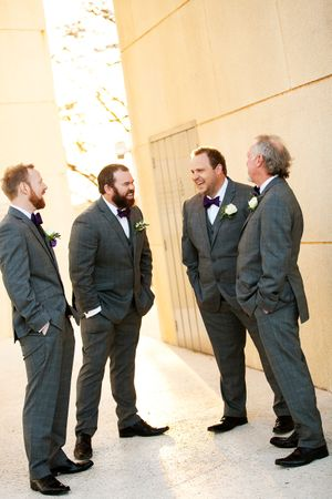 Groom and groomsmen standing around laughing at The Carillon Lake Burley Griffin in Canberra