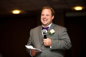 Best Man smiling while giving a speech at Hotel Realm Barton wedding in Canberra