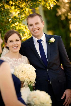 Bride and groom smiling at their bridal party at Lake George Winery in Canberra