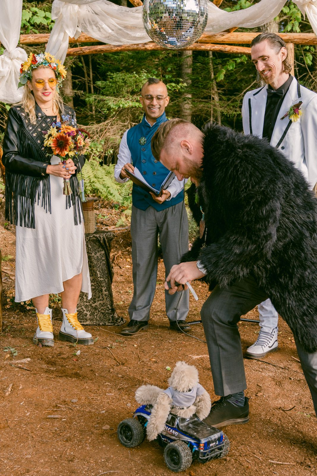 Ring arriving at a wedding on a stuffed animal sloth