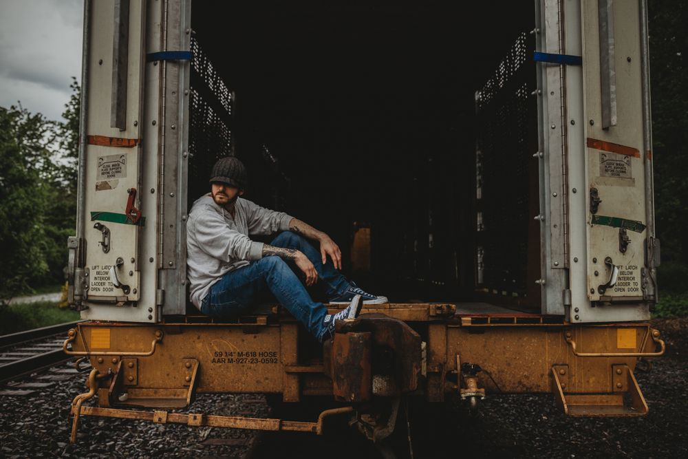man looking away sitting in train car, issaquah wa by shutterbabe snapshots