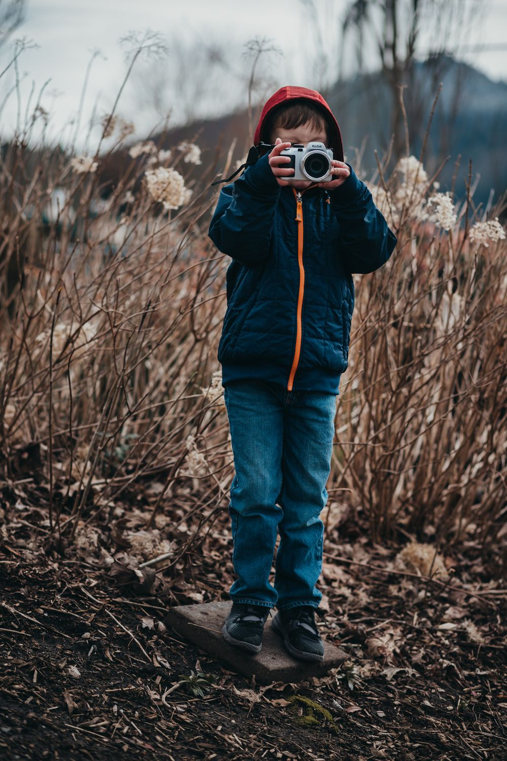 young boy holding a camera and taking a picture, issaquah wa by shutterbabe snapshots
