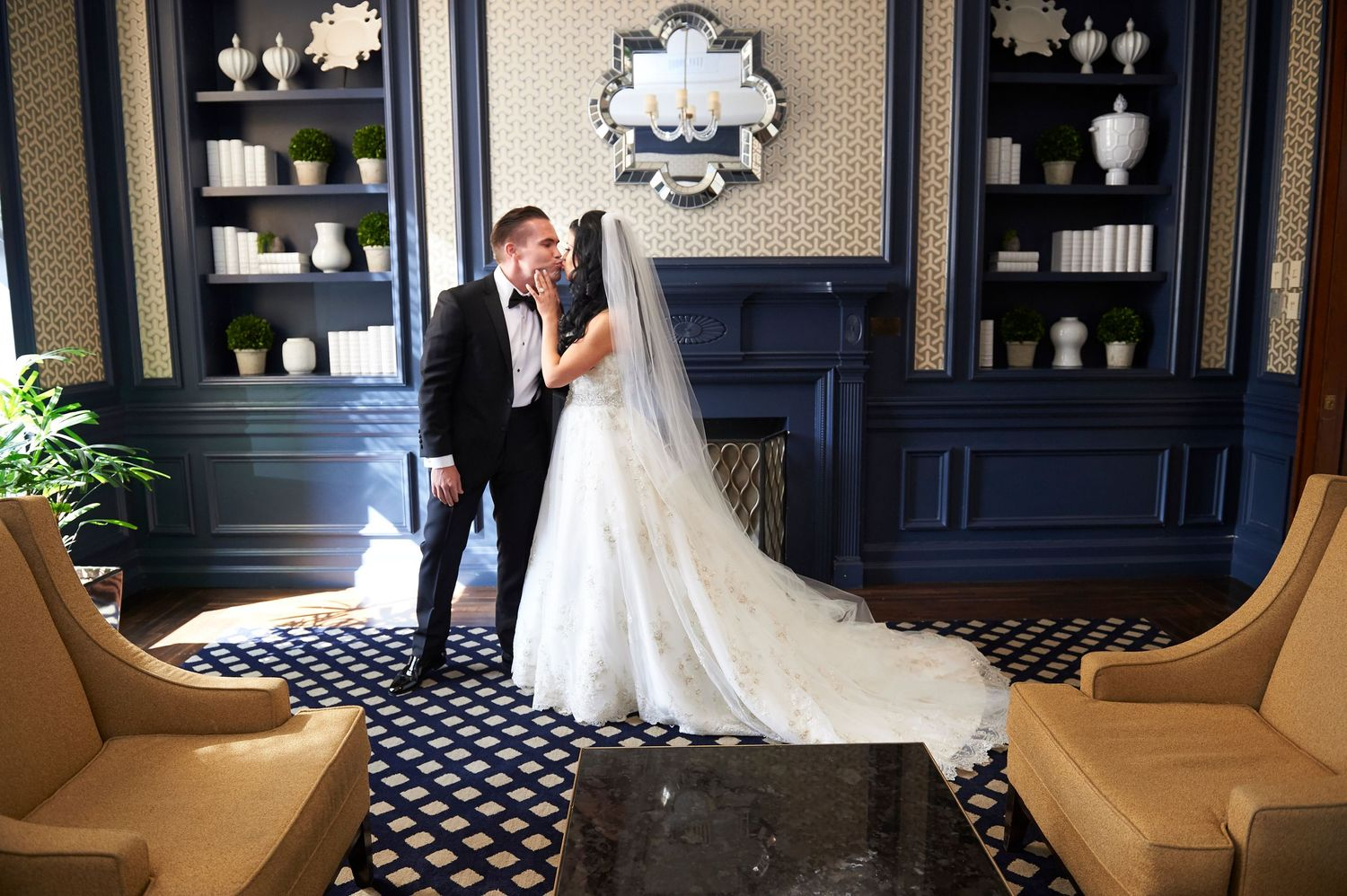 groom kisses bride during first look at the Marriott in Old City Philadelphia