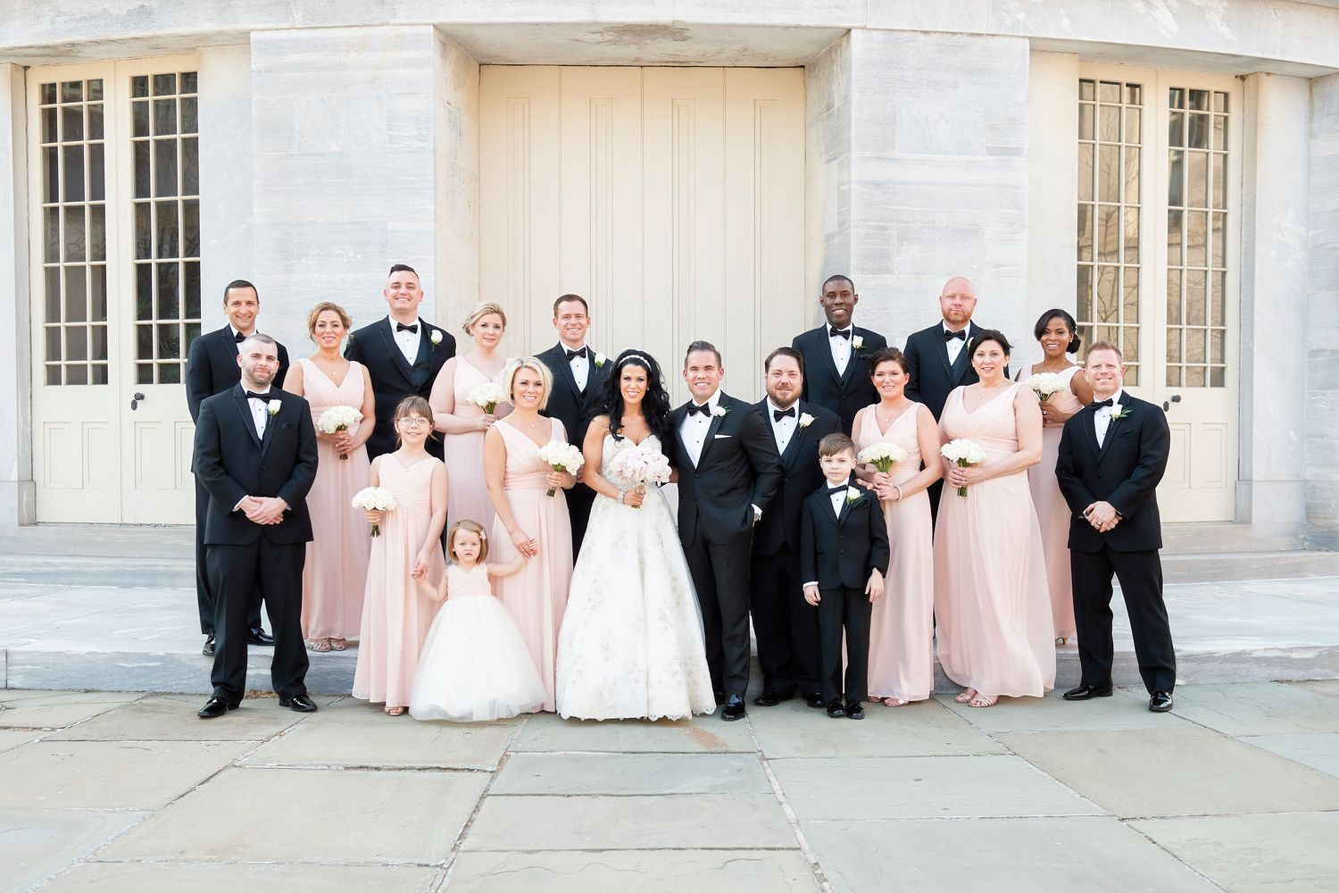 bridal party at Merchant Exchange Building in old city philadelphia