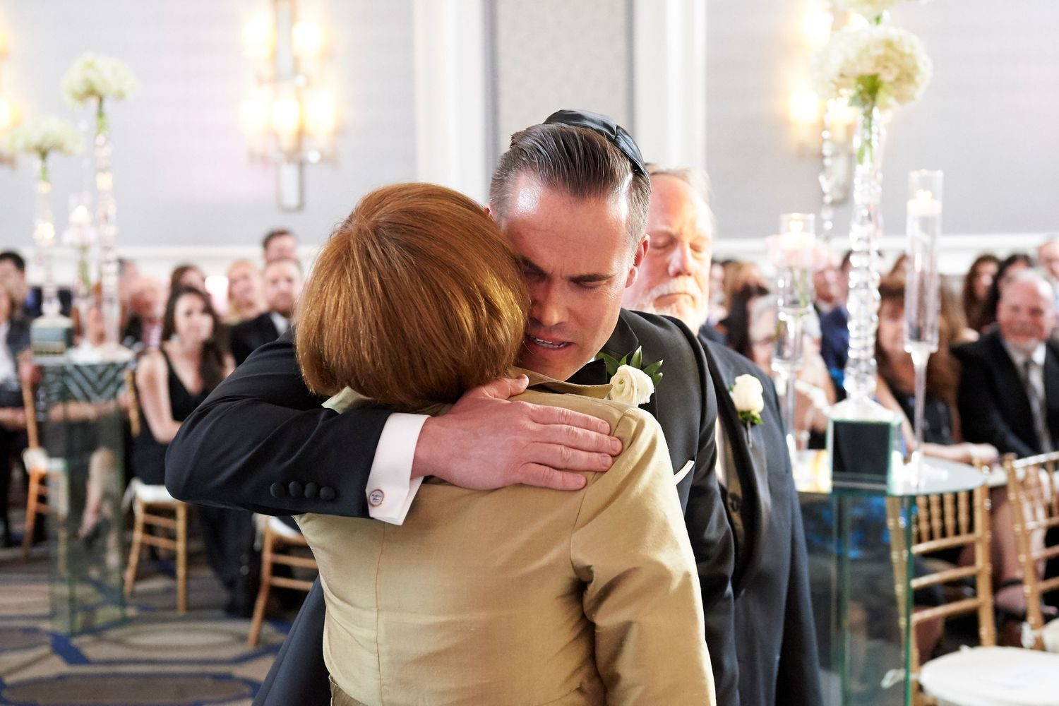 groom hugs mom during ceremony at the Marriott in Old City Philadelphia