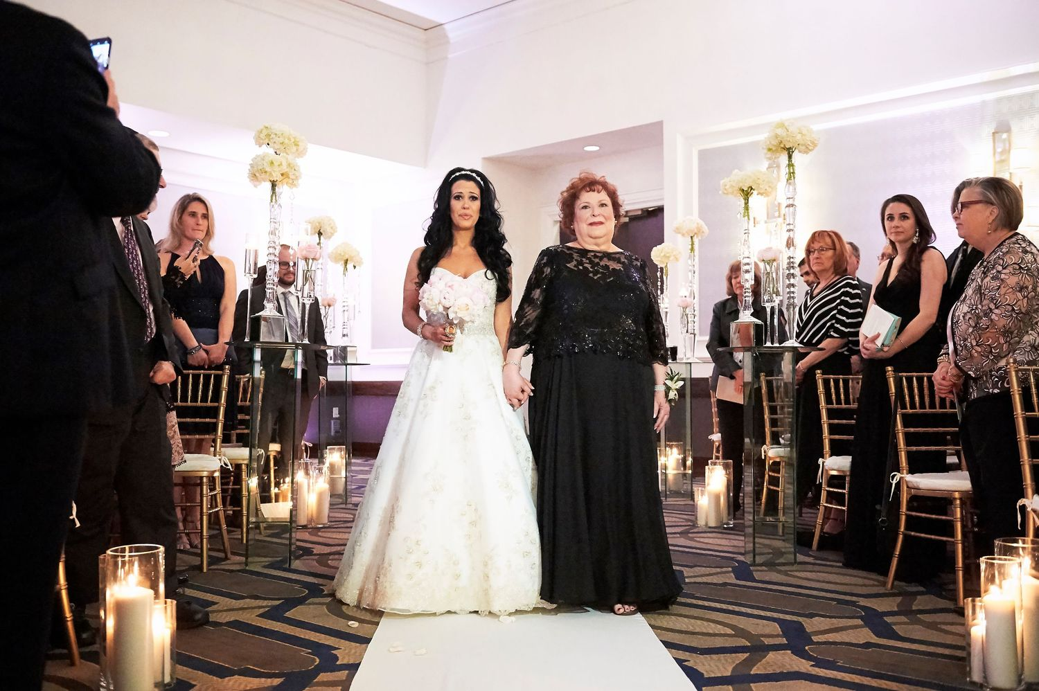 bride escorted by mom during ceremony