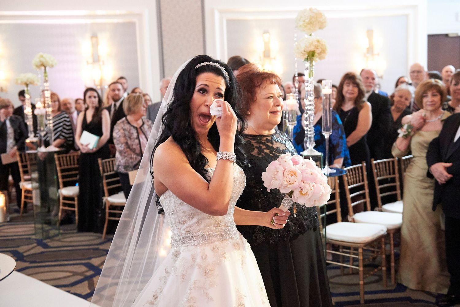 bride wipes tear during ceremony at the Marriott in Old City Philadelphia