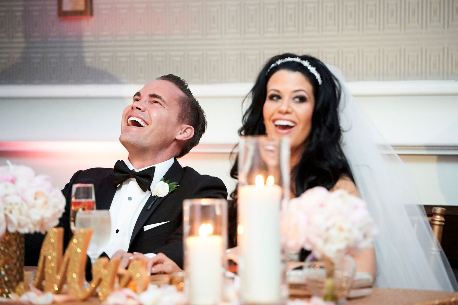 bride and groom laughs during speeches