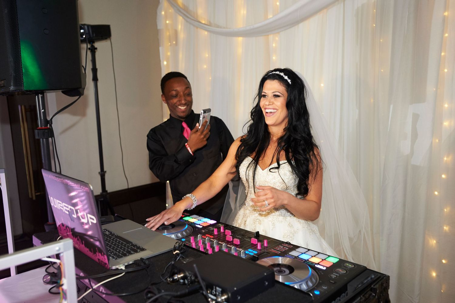 bride plays DJ during the reception at the Marriott in Old City Philadelphia