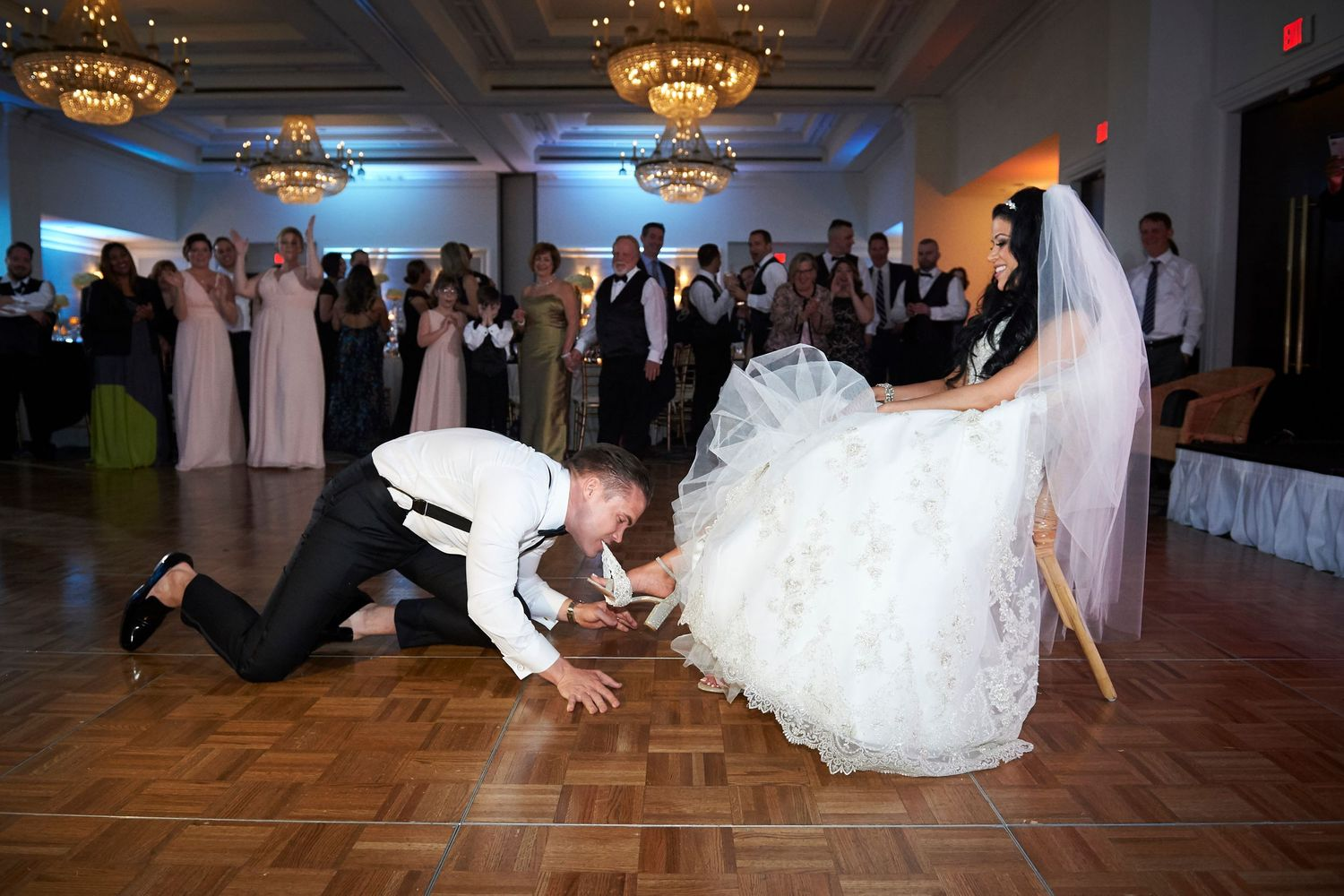 groom uses teeth to pull off the garter