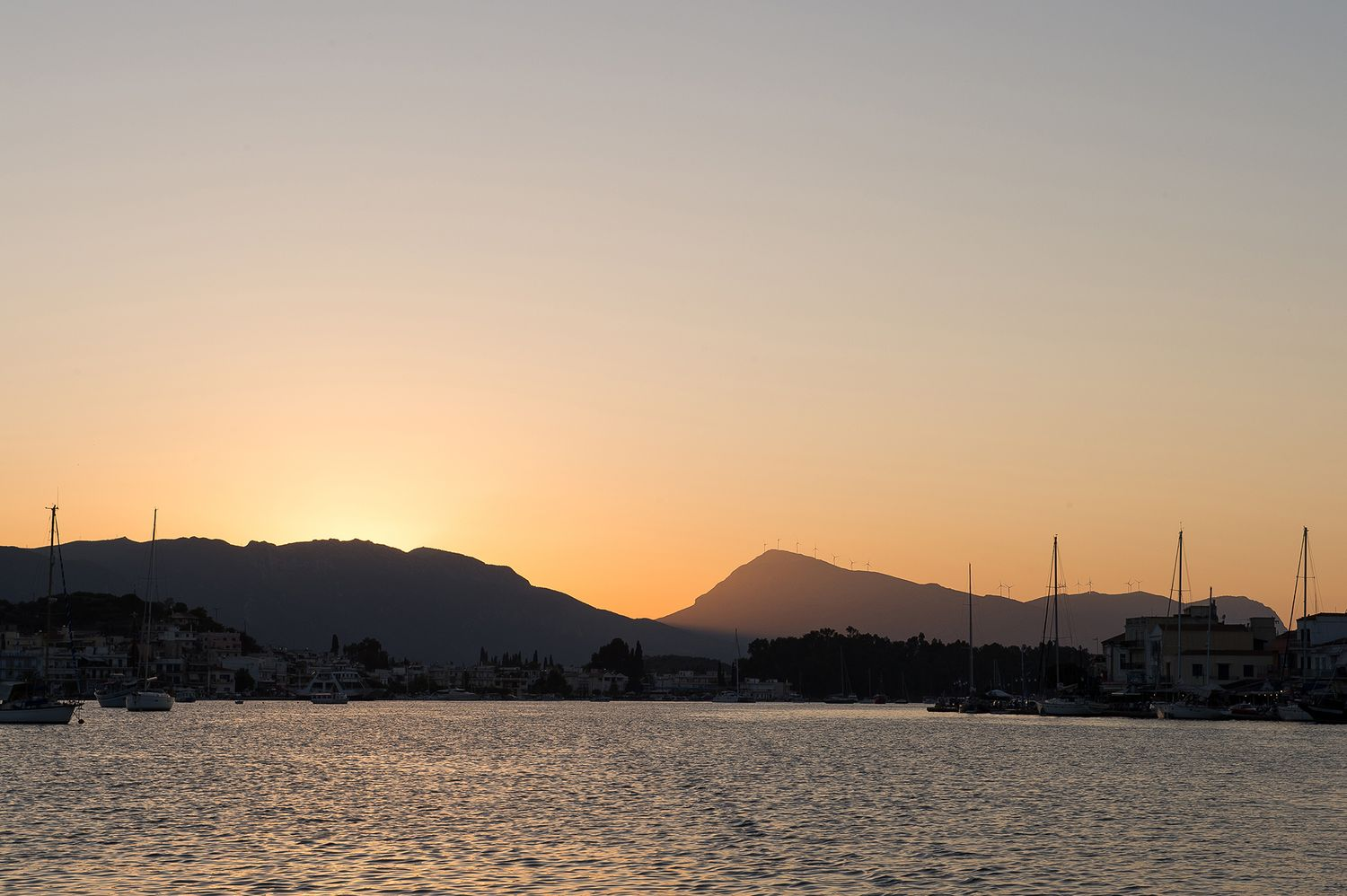 landscape of poros island during the sunset