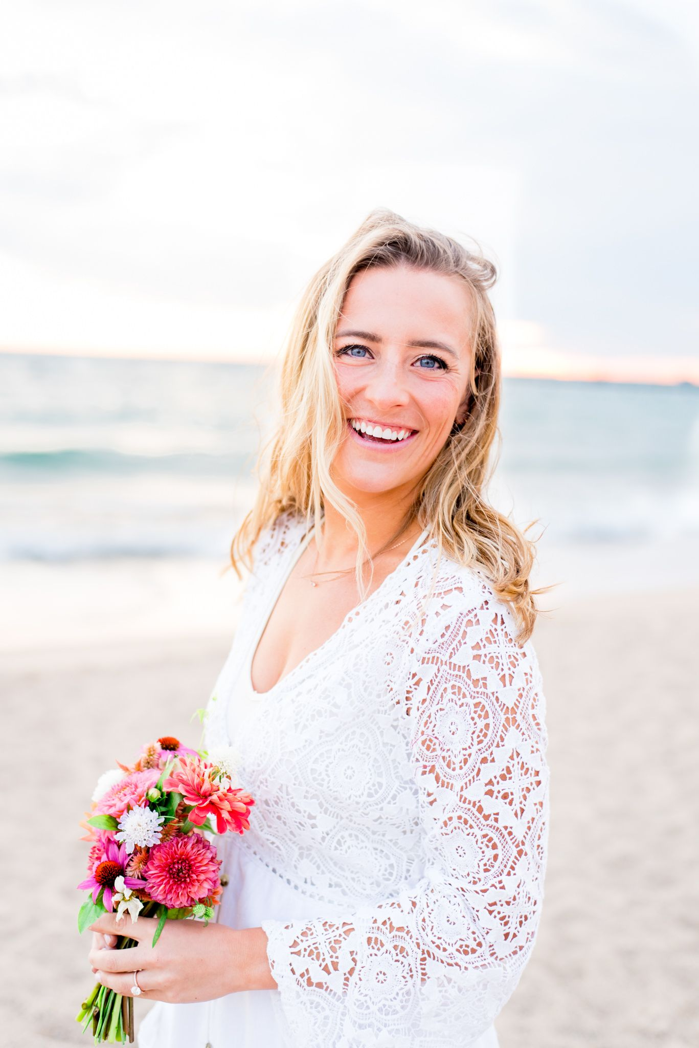 bride smiling on North Avenue Beach for Chicago sunrise engagement pictures