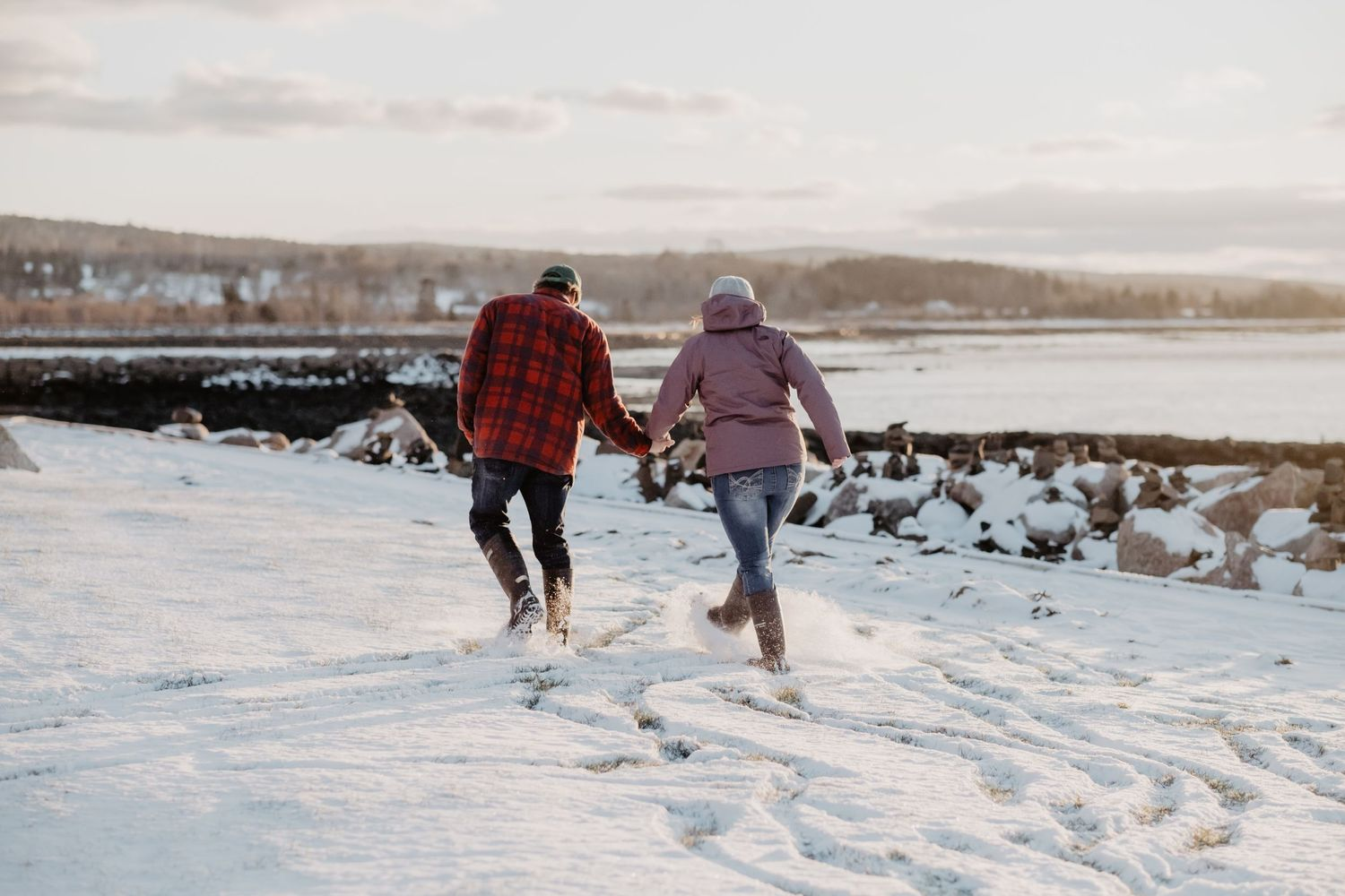 running in snow winter engagement sunset