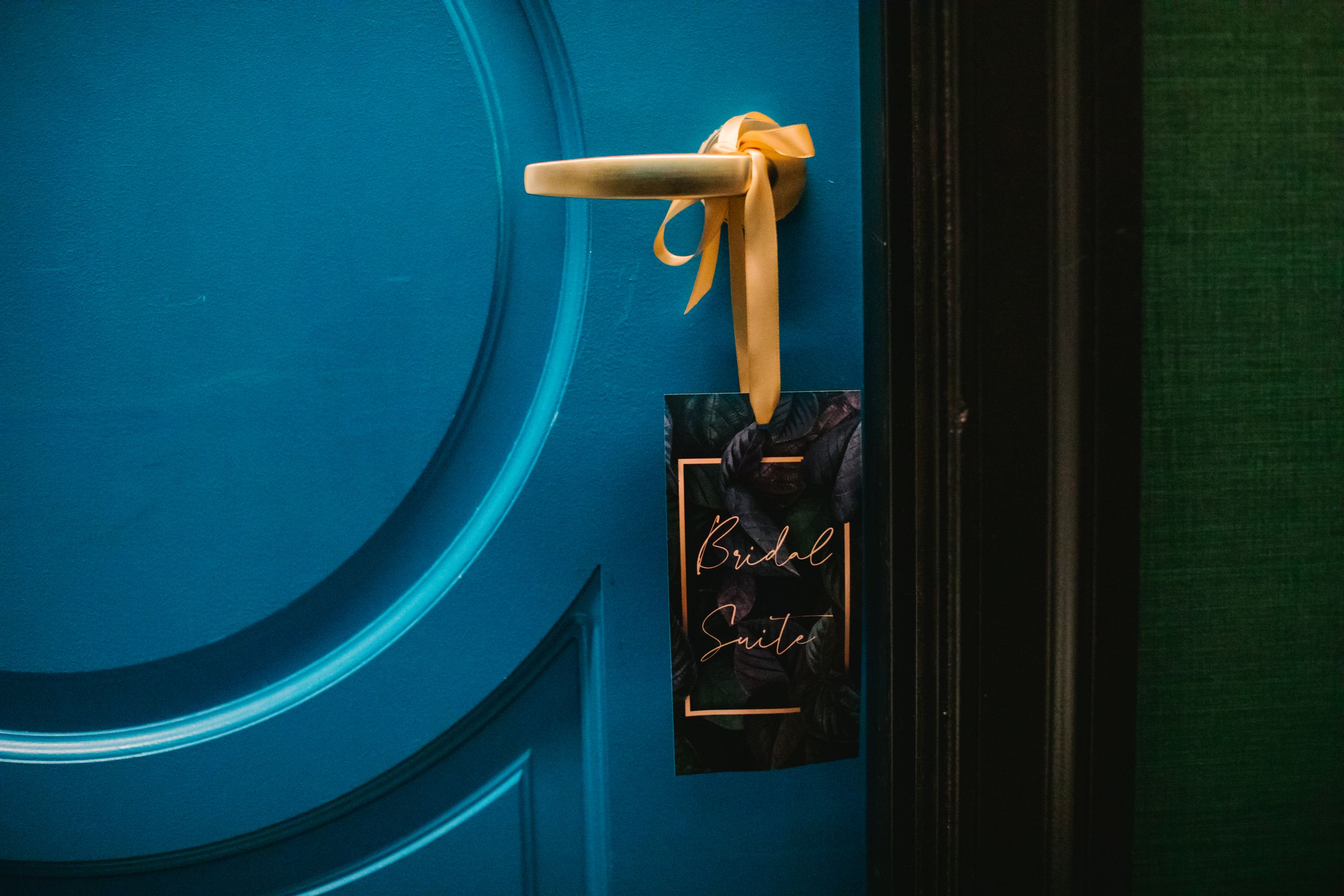 blue door with black bridal suite sign on it